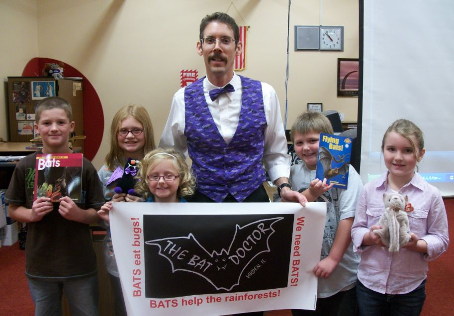 Dr. Austin with North Mac Virden Elementary students, following a bat Powerpoint program